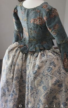 18th c teal silk brocade jacket (possibly Spitalfields). UK. 18th c French silk skirt with ruffle trimmed front and side ties.