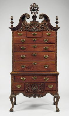 Chest of drawers, 1755–90, Philadelphia, Mahogany, tulip poplar, yellow pine. 99 x 45 1/2 x 25 in. (251.5 x 115.6 x 63.5 cm). Immigrant craftsmen in Philadelphia produced the most elaborate and richly carved of all colonial American furniture. This high chest demonstrates how Philadelphia artisans updated traditional Baroque forms by adding carved Rococo-style ornament.