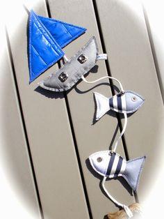 Strandmobiel, boot met vissen