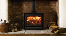 What is the Difference between a Wood Burning and Multi-Fuel Stove? Wood Stove Surround, Wood Stove Hearth, Wood Burner Fireplace, Inglenook Fireplace, Brick Fireplace, Fireplace Design, Fireplaces, Modern Wood Burning Stoves, Log Burning Stoves