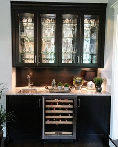 I love the glass door uppers and would love this in a light grey cabinet with white quartz countertops