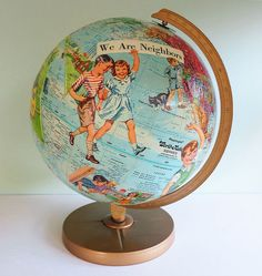 If you ever come across a vintage globe for sale that is no longer geographically accurate, don't pass it up. Instead, buy it! Then when you're feeling crafty, use it as the canvas for this worldly art project. Gotta get one of these globes. Globe Projects, Globe Crafts, Map Crafts, Art Projects, Arts And Crafts, Old Globe, Globe Art, Globe Decor, Kitsch