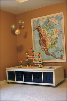 Play table for the kids with storage for all the toys!  LOVE IT! Love the whole space