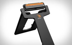 Carzor. This handy gadget combines a razor, blade storage, and a mirror in a collapsible, credit card-sized package.