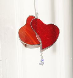 Love these suncatchers...want a powder blue sofa with red accents like this