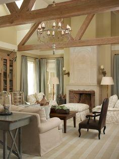 FaBulous off white living room, stone mantel, wood truss ceiling.