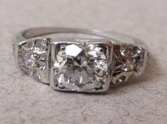 A personal favorite from my Etsy shop https://www.etsy.com/listing/194466691/antique-deco-80-carat-diamond-platinum