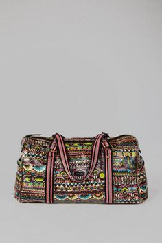 The Sakroots Artistic Circle XL Duffel is a must-have for any weekend getaway. This durable bag features a neon tribal print allover. With a back sleeve that easily attaches to your suitcase, you'll be able to move through the airport with ease! Finished with a front pocket and two side pockets with magnetic closures, a back zipper pocket, an interior zipper pocket, and two interior open pockets. Pair with your favorite Sakroots suitcase for the perfect look!  #canihaveitalready