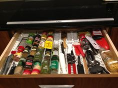 2nd floor - Kitchen - Range wall - top lower cabinet drawer (G4) - spice drawer (Variera organizer | Ikea - $4) [PRODUCT]