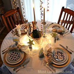 New Years Eve Table of Black, Gold and Silver is timeless elegance. Sheer fabric is lit f adding a gorgeous glow. Free printable place cards and Stars too! Printable Name Tags, Printable Place Cards, Free Printable, New Years Eve 2015, New Year Table, Elegant Table Settings, New Year Celebration, Love Home, Bright Lights