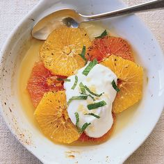 Gingered Orange Gratin |Grace Parisi mixes cold whipped crème fraîche with candied ginger, then spoons it over warm, sweet orange slices. The combination of flavors, textures and temperatures is magnificent. Food & Wine