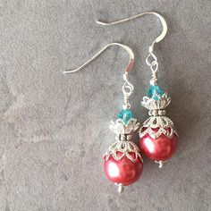 Bright coral and aquamarine glass pearl dangle earrings are made with 10mm coral glass pearls along with silver tone filigree beads, and topped with light turquoise Swarovski crystals. The earring wires are Sterling silver fishhook style earwires.  Matching bracelets: https://www.etsy.com/listing/530028066/pearl-bridesmaid-bracelets-coral-pearl Matching necklaces: https://www.etsy.com/FiveLittleGems/listing/543821923/coral-pearl-necklace-...