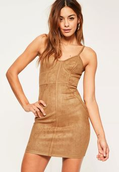 Be a faux suede beaut in this mini dress - featuring a tan hue, binding detail, a country tan hue and a luxe faux suede finish.