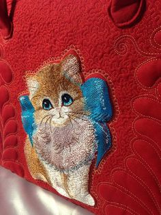 Kitten with bow machine embroidery design on bag