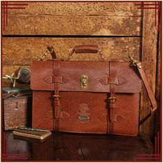 Distinguished military style handcrafted, polished leather briefcase. Brass hardware. Inside dividers, pockets for tablets / tech items. Fits most laptops.