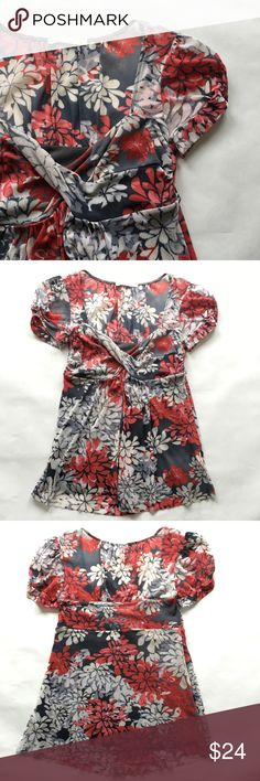 """Anthropologie Floral Top Floral top from Weston Wear for Anthropologie.  Floral pattern in red, gray, beige and ivory. Super light and flowy - 100% nylon. Cross front v-neck, gathered sleeves, slight shirting below waist and empire waist make for flattering fit. 25"""" long. Please see LAST PHOTO: slight irregularity in fabric (darker brown fabric mark) that is not very noticeable. In excellent condition! Anthropologie Tops Blouses"""