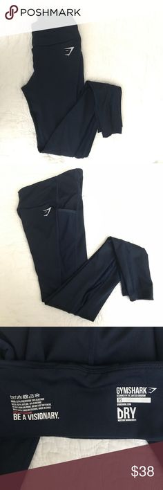 Gymshark Dry Sculpt Leggings Item is in like new condition only worn twice. See through details on the sides. Leggings go down to the ankle and fit semi high waisted. Color is a deep navy blue Gymshark Pants Leggings