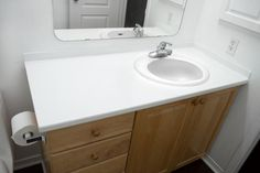 Quick and affordable projects to update your bathroom in one day, from painting cabinets, to DIY shower curtains and bathtub trays. Tons of great ideas to try.: DIY Painted Bathroom Counters