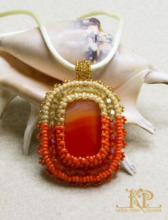 Pendant with glass cabochons