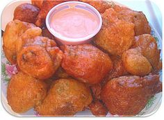 Cooking With Sugar: Conch Fritters. 4 cups cooking oil campaignIcon Coupons 2 medium conch ½ small sweet pepper – finely chopped campaignIcon 1 small finely chopped onion 1 egg campaignIcon 1 cup milk 2 tbsp. tomato paste 1 tsp. baking powder 1 cup flour Salt and pepper to taste