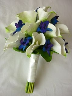calla lilies with blue orchids bouquet