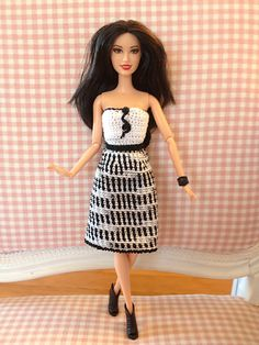 With tiny black buttons and a pretty color scheme, your Barbie will be ready to go to a cocktail party with this fashions statement. It looks much more difficult than it really is!