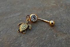 Turtle Gold Belly Ring Navel Ring Body Jewelry 14ga Surgical Steel Piercing Jewelry from BodyDazzles.net. Saved to Body Jewelry.