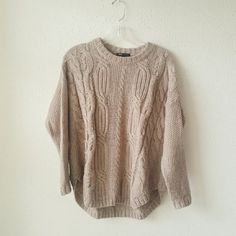 """Knit Sweater Re-posh. Personally never worn. Size is XS but might be too big so recommended for S. Oversize fit. There is an unintended hole by one of the sleeves. Shown in last pic. Color is a beige-y taupe. 75% acrylic 25% wool.  Length: 26.5"""" Width: 22"""" Sleeve: 21.5""""  PRICE FIRM MNG casual Sweaters Crew & Scoop Necks"""