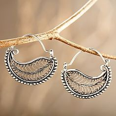 Indonesian Filigree Hoop Earrings | National Geographic Store, Chand bali are traditional Southeast Asian earrings with crescent moon-shaped decoration, worn by girls and women of all ages. Here, Indonesian jewelers borrow that classic style and add their own twist—a curved filigree leaf nestled within a circle that represents the fulfillment of life's duty, an important part of Indonesian spiritual beliefs. Sterling silver.