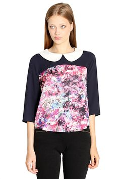 The Sugarlips Prep School Art Project Top is a muticolor abstract printed top with navy sleeves and a white peter pan collar. Pair it with a black skirt, knee highs, and oxfords. School girl taken to the next level. Features a cutout in the back with a draping detail and three button closure. #MyLuluCloset #Sugarlips #Storenvy #Sales #Tops