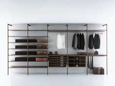 "Porro Spa | <p align=""LEFT"">The walk-in closet allows, thanks to beams and uprights, the unique self-standing units of the entire structure, makin"