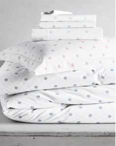 We've reimagined the dot! Using soft, vertical lines to convey delicate dots in an understated color palette, we have created a design that's playful yet subtle, and easy to coordinate with other prints. Even better, our Dottie pattern is on our classic soft percale.200 thread count long-staple cottonDuvet Cover has a hidden button closure along the bottom, and inside ties in each corner to anchor your duvet/comforterSham has overlap flap closureFitted sheet is fully elasticized for a better…