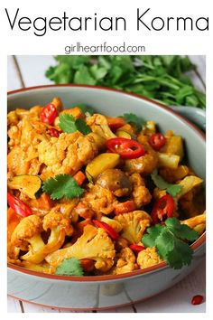 A homemade take on a favourite Indian take out dish, this one pot Veggie Korma Curry is so tasty! It's absolutely loaded with veggies like zucchini, bell pepper, cauliflower, carrot and onion and cooked in a flavourful curry based cream sauce dotted with cashews for extra flavour and texture. #fakeawayrecipe #indianrecipe #vegetarian #korma #vegetariankormawithcream #glutenfree #onepot #comfortfood #meatlesskorma