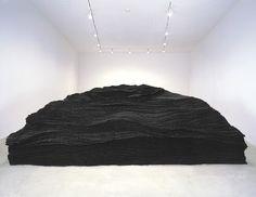 Tara Donovan, Transplanted, 2001. Ripped and stacked tarpaper