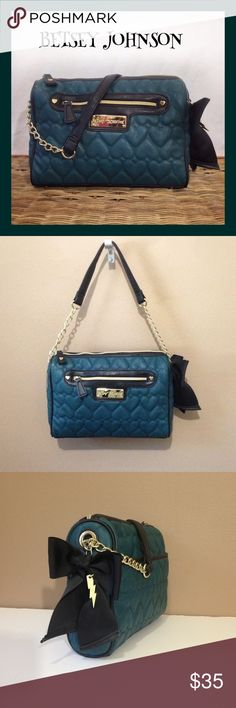 """Betsey Johnson """"Be Mine"""" collection Purse Excellent used condition. Used maybe twice! Quilted hearts in green with black trim and gold hardware. Zip closure and large exterior zip pocket in the front. Exterior back pocket snaps closed. Interior has signature lining with 3 pockets (1 zips). Half chain strap with a drop of 9"""" long. Little feet on the bottom and black bow with little lightning hang tag. Betsey Johnson Bags Shoulder Bags"""