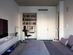 Small bedroom design ideas with hidden desk.