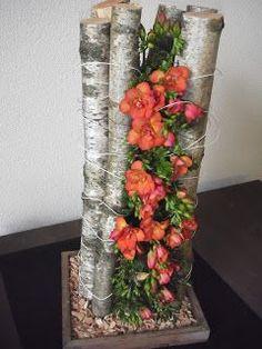 Vertical flower arrangement between branches of birch ~ Willy de Wilde