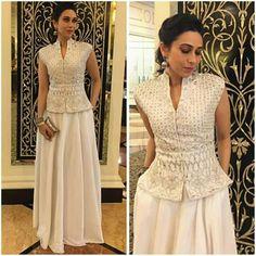 Karisma Kapoor goes festive in white in this bandi & skirt.