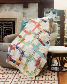 Pretzel Twist, by Jane Vaughn, features interlocking squares - a feast for the eyes! Making this throw quilt pattern is fun with pre-cuts - just pay attention to color placement.