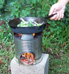 "Rocket stove in use - everyone needs to know how to build/use one of these for ""those"" times when there's no other way to cook.  Used to make these as a kid during summer."