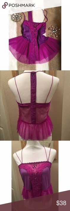Pretty Free People cami Love love love this frilly, pretty cami by Free People. Size is small. Has black and purple gems, purple lace with gold accents and pretty tulle. It is pre-loved but in great shape. Free People Intimates & Sleepwear