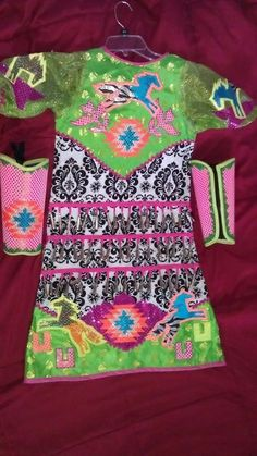 Girl's Jingle Dress sz 8-10: Vibrant multi-colored horses, floral, and geometric desing on green sarai, and black and white french tule fabric                    www.shawneedesignz.com