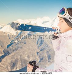Ski. Female skier on the background of high snow-capped Alps in Swiss