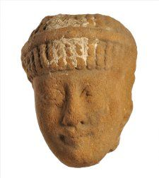 Egyptian terracotta figure. Man (?) with braided hair bound with cord.   (mid)5thC BC, Naukratis  Terracotta 1545Terracotta C619