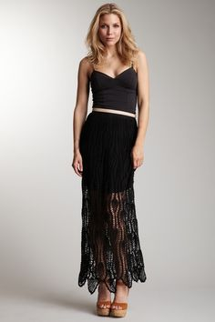 - Crochet overlay black skirt with solid lining, worn with black spaghetti strap (show some cleavage) top  - Shark-bite hem