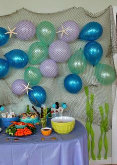 Mermaid theme party- love the seaweed streamers!