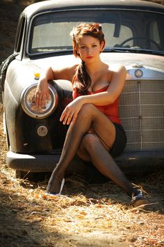Beautiful girl posing with a classic Mercedes Benz