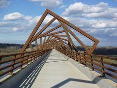 The High Trestle Bridge in Iowa traverses the Des Moines River with true contemporary flare. Funny Wednesday Memes, Justin Bieber Jokes, Muffins, Pedestrian Bridge, Op Art, Public Art, Girl Humor, Landscape Architecture, Architecture Tools