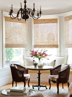 A built-in bench gives this space a relaxed vibe. See the rest of this home: design and decoration interior design ideas design de casas Outdoor Blinds, Outdoor Rooms, Patio Blinds, Diy Bamboo, Bay Window Treatments, Window Coverings, Best Hacks, Woven Shades, Bamboo Shades
