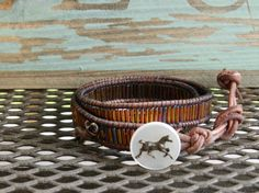 Bugle bead and leather wrap bracelet with horse by Provincial
